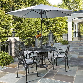 Home Styles Largo Collection 48'' Diameter 5-Piece Outdoor Dining Set w/ Umbrella and Cushions (Includes: (1) Round Table, (4) Arm Chairs, (4) Seat Cushions, (1) Umbrella and (1) Umbrella Stand), Charcoal Finish