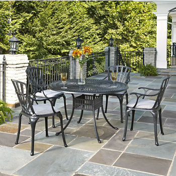 Home Styles Largo Collection 48'' Diameter 5-Piece Outdoor Dining Set w/ Cushions (Includes: (1) Round Table, (4) Arm Chairs and (4) Seat Cushions), Charcoal Finish